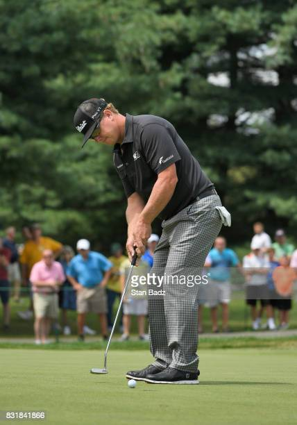 Charley Hoffman hits a putt on the first hole during the final round of the World Golf ChampionshipsBridgestone Invitational at Firestone Country...