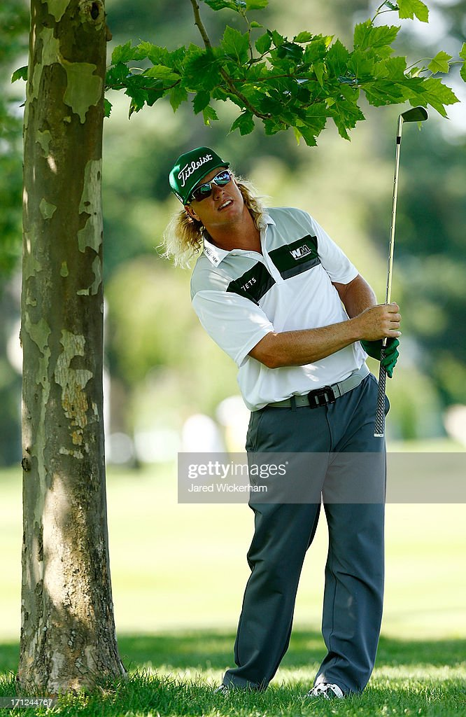 <a gi-track='captionPersonalityLinkClicked' href=/galleries/search?phrase=Charley+Hoffman&family=editorial&specificpeople=578840 ng-click='$event.stopPropagation()'>Charley Hoffman</a> hits his shot next to a tree during the final round of the 2013 Travelers Championship at TPC River Highlands on June 23, 2012 in Cromwell, Connecticut.