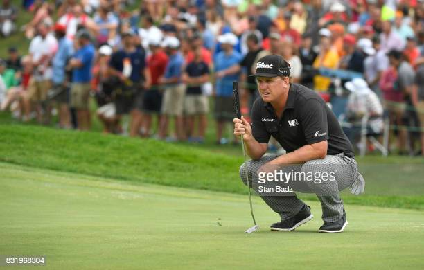 Charley Hoffman lines up his putt at the 18th hole during the final round of the World Golf ChampionshipsBridgestone Invitational at Firestone...