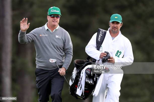 Charley Hoffman of the United States and caddie Brett Waldman react on the 18th hole during the first round of the 2017 Masters Tournament at Augusta...