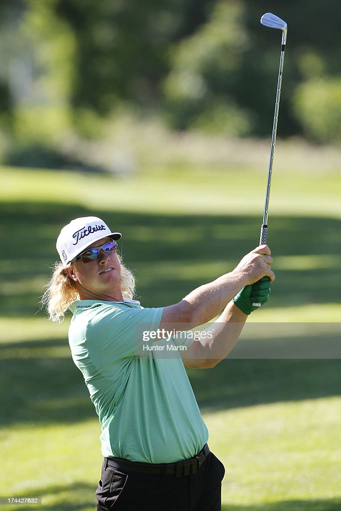 <a gi-track='captionPersonalityLinkClicked' href=/galleries/search?phrase=Charley+Hoffman&family=editorial&specificpeople=578840 ng-click='$event.stopPropagation()'>Charley Hoffman</a> of the United States hits his second shot on the 16th hole during round one of the RBC Canadian Open at Glen Abby Golf Club on July 25, 2013 in Oakville, Ontario.