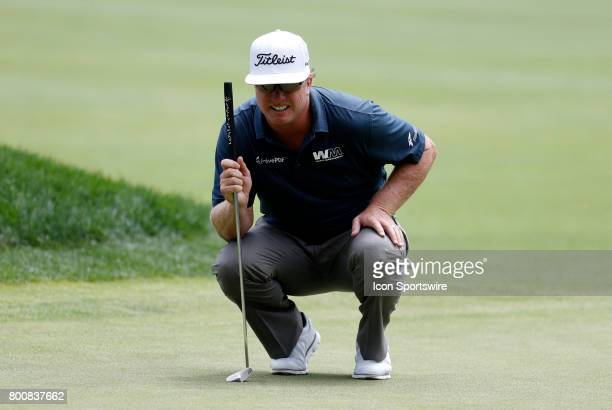 Charley Hoffman of the United States lines up his putt on 7 during the final round of the Travelers Championship on June 25 at TPC River Highlands in...