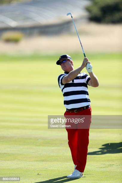 Charley Hoffman of the United States plays his second shot on the 14th hole in his match against Jason Day of the International Team during the final...