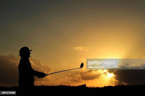 Charley Hoffman of the United States plays his shot from the 18th tee during the third round of the Hero World Challenge at Albany Bahamas on...
