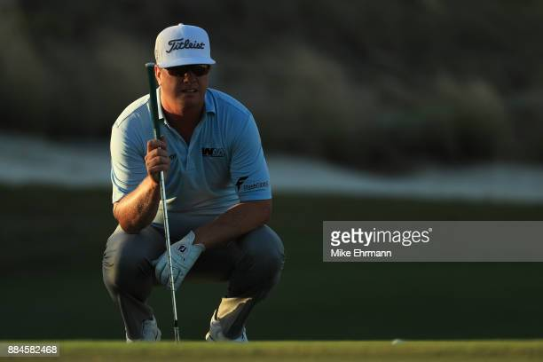 Charley Hoffman of the United States prepares to play a shot on the 17th hole during the third round of the Hero World Challenge at Albany Bahamas on...