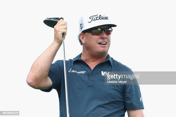 Charley Hoffman of the United States reacts after playing his shot from the ninth tee during the final round of the Travelers Championship at TPC...