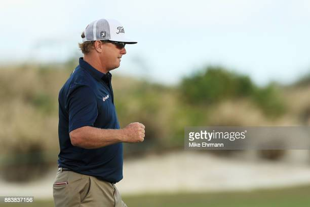 Charley Hoffman of the United States reacts to his birdie on the 18th green during the second round of the Hero World Challenge at Albany Bahamas on...