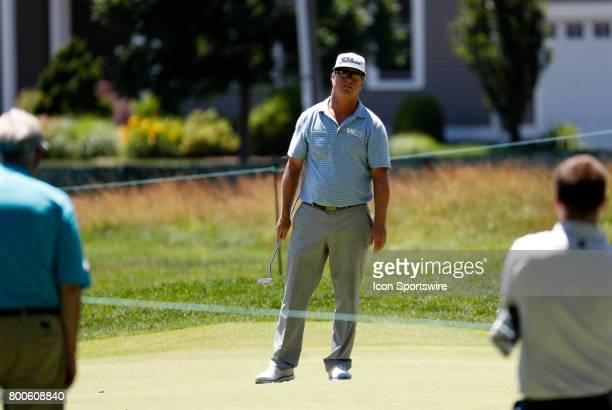 Charley Hoffman of the United States scowls at his putt on the 7th green during the third round of the Travelers Championship on June 24 at TPC River...