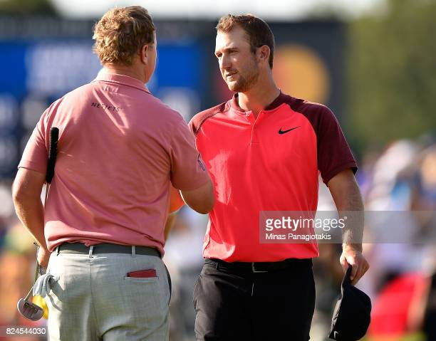 Charley Hoffman of the United States shakes hands with Kevin Chappell of the United States on the 18th hole during the final round of the RBC...