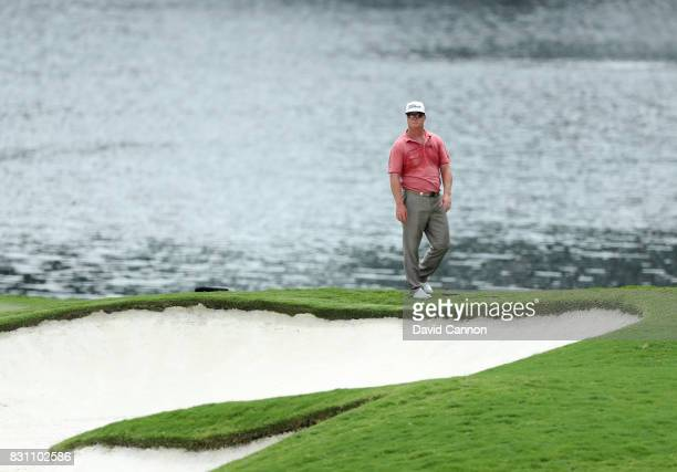 Charley Hoffman of the United States waits beside the green on the par 4 16th hole during the final round of the 2017 PGA Championship at Quail...