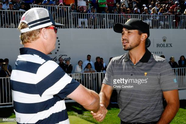 Charley Hoffman of the US Team and Jason Day of Australia and the International Team shake hands on the first tee during the Sunday singles matches...