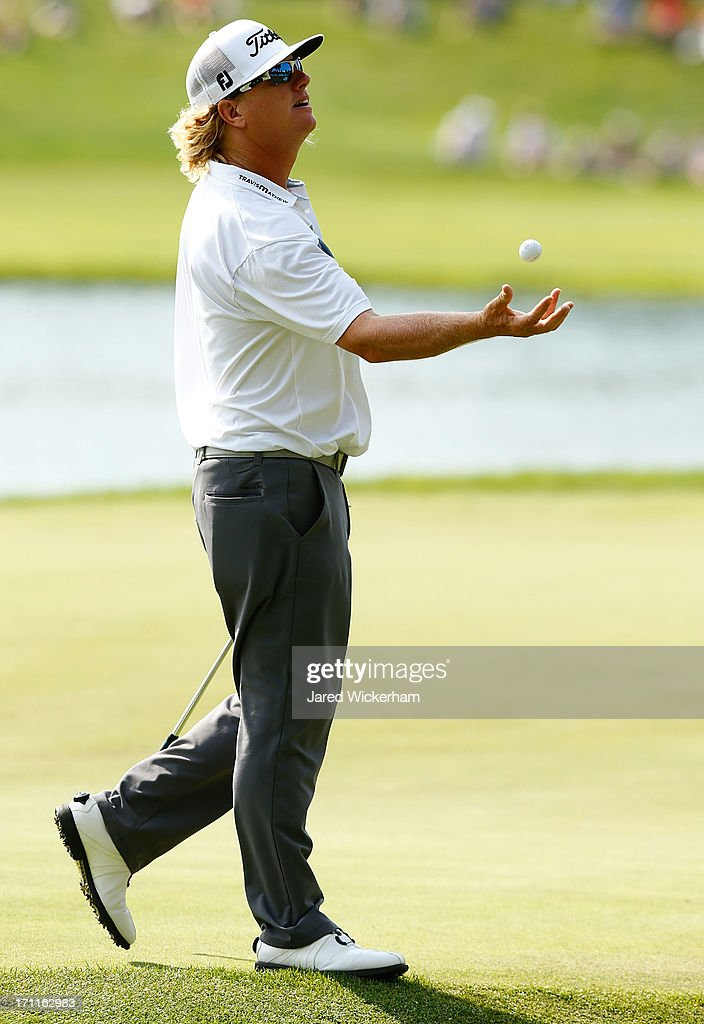 Charley Hoffman throws a golf ball up in the air on the 15th hole during the third round of the 2013 Travelers Championship at TPC River Highlands on June 22, 2012 in Cromwell, Connecticut.