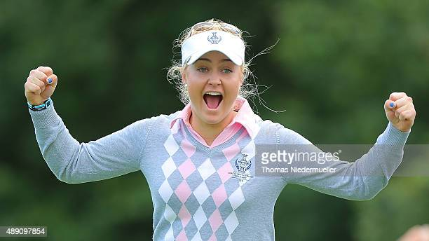 Charley Hull celebrates at the 18th hole during the morning foursomes matches in the 2015 Solheim Cup match at St LeonRot Golf Club on September 19...