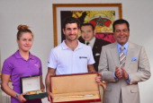 Charley Hull of England and Alejandro Canizares of Spain are presented with their winners trophies by HRH Prince Moulay Rachid after the final round...