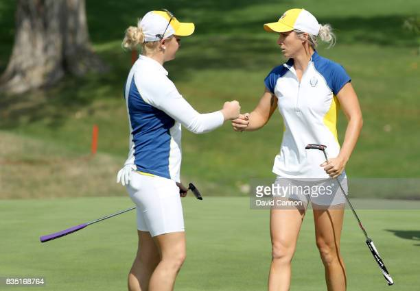 Charley Hull of England and the European Team celebrates with Melissa Reid after they had won the 12th hole in their match against Cristie Kerr and...