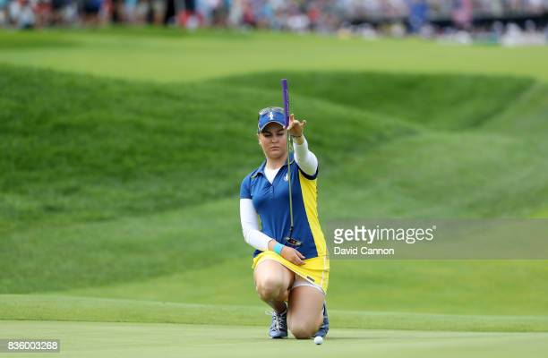 Charley Hull of England and the European team in action against Brittany Lang of the United States team during the final day singles matches in the...