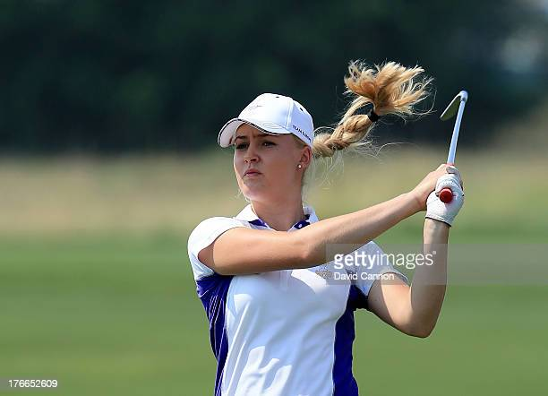 Charley Hull of England and the European Team plays her second shot at the 4th hole during the afternoon fourball matches for the 2013 Solheim Cup at...