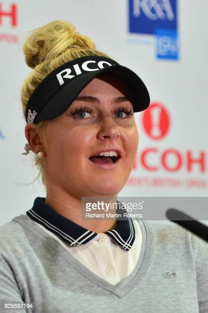 Charley Hull of England answers questions from the media at a press conference during a practice round prior to the Ricoh Women's British Open at...