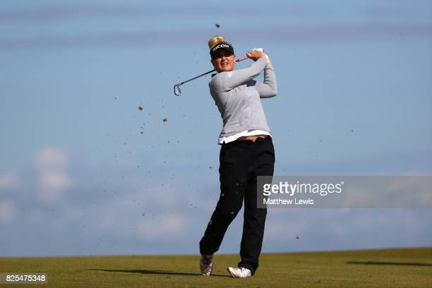 Charley Hull of England hits an approach shot during a practice round prior to the Ricoh Women's British Open at Kingsbarns Golf Links on August 2...