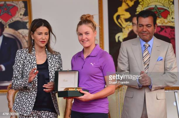 Charley Hull of England is presented with her winners trophy by HRH Prince Moulay Rachid after the final round of the Lalla Meryem Cup at Golf du...