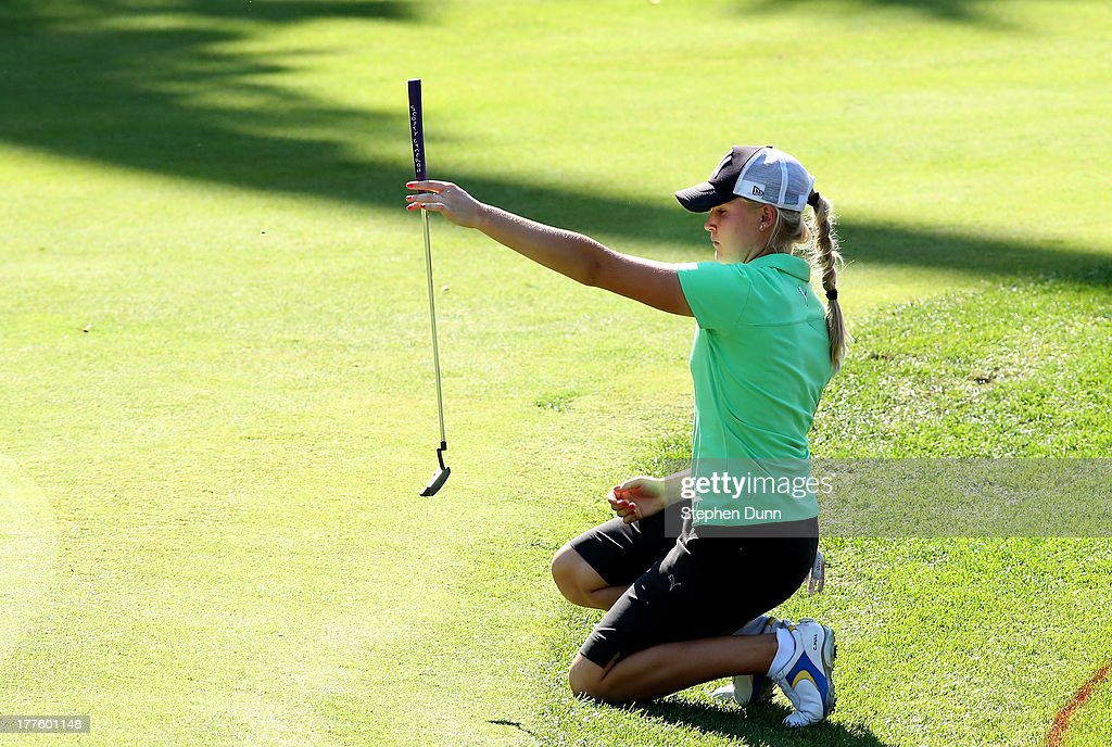 <a gi-track='captionPersonalityLinkClicked' href=/galleries/search?phrase=Charley+Hull&family=editorial&specificpeople=7118530 ng-click='$event.stopPropagation()'>Charley Hull</a> of England lines up a putt on the 18th hole during the third round of the CN Canadian Women's Open at Royal Mayfair Golf Club on August 24, 2013 in Edmonton, Alberta, Canada.