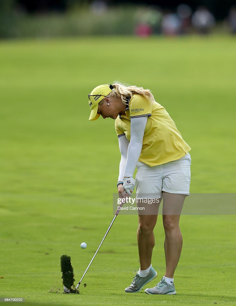Charley Hull of England plays her second shot at the 13th hole during the third round of the 2016 Ricoh Women's British Open on July 30 2016 in...