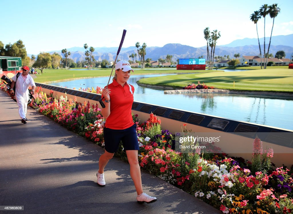 Charley Hull of England walks to the green at the par 5 18th hole during the third round of the 2014 Kraft Nabisco Championship on the Dinah Shore...