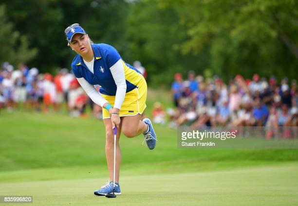 Charley Hull of Team Europe reacts to a putt during the final day singles matches of The Solheim Cup at Des Moines Golf and Country Club on August 20...
