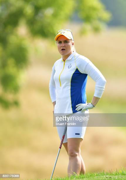 Charley Hull of Team Europe reacts to a shot during the morning foursomes matches of The Solheim Cup at Des Moines Golf and Country Club on August 18...
