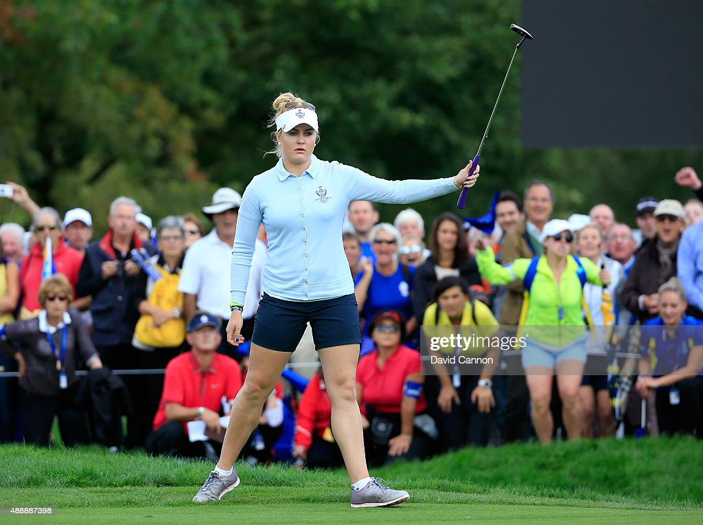 Charley Hull of the European Team celebrates holing a birdie putt from just off the 17th green to seal a 21 win with her partner Melissa Reid against...
