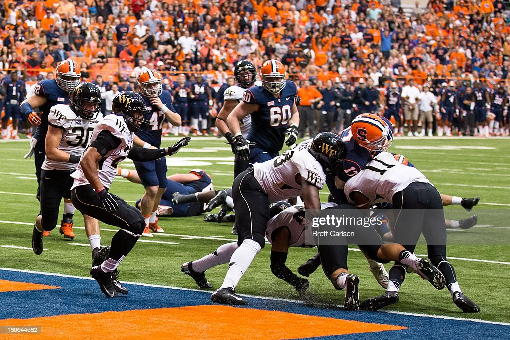 Charley Loeb #17 of Syracuse Orange is stopped at the goal line during a fake field goal attempt against Wake Forest Demon Deacons on November 2, 2013 at the Carrier Dome in Syracuse, New York. Syracuse shuts out Wake Forest 13-0