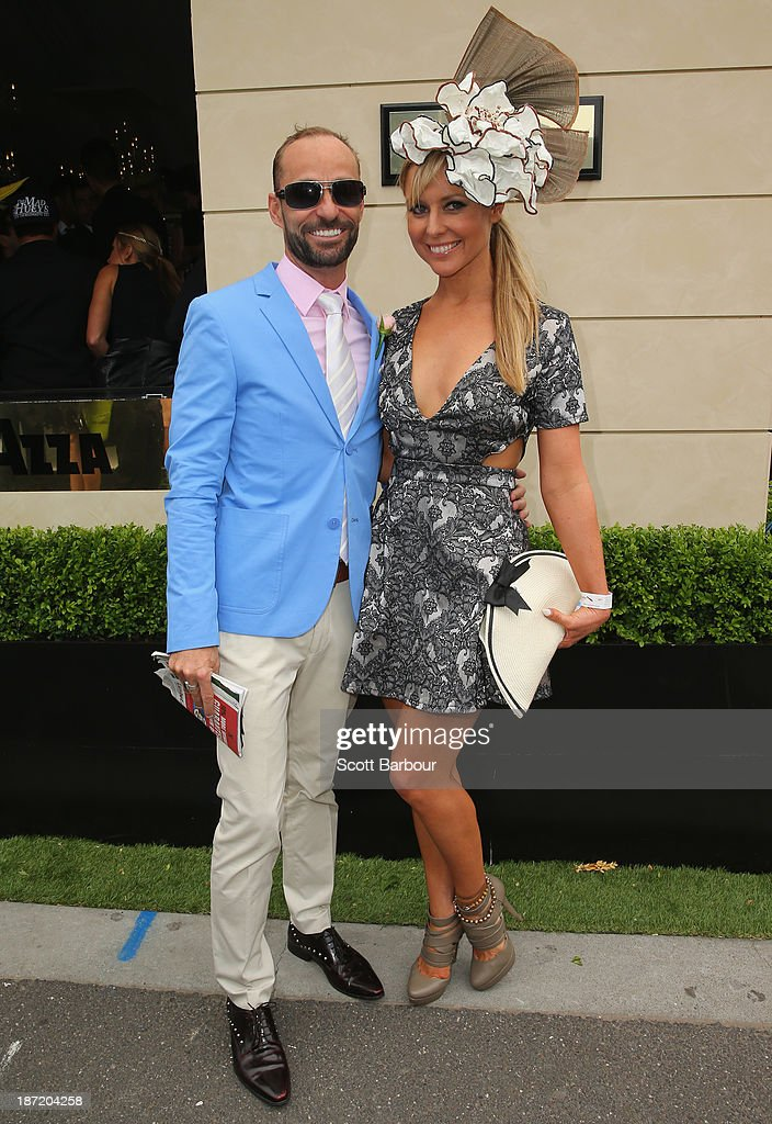 Charli Robinson and Brent Delaney attend during Oaks Day at Flemington Racecourse on November 7, 2013 in Melbourne, Australia.
