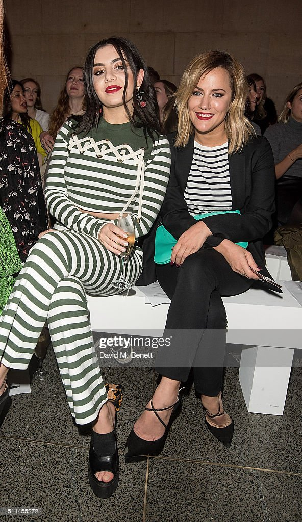 Charli XCX and Caroline Flack attend the House of Holland show during London Fashion Week Autumn/Winter 2016/17 at TopShop Show Space on February 20, 2016 in London, England.