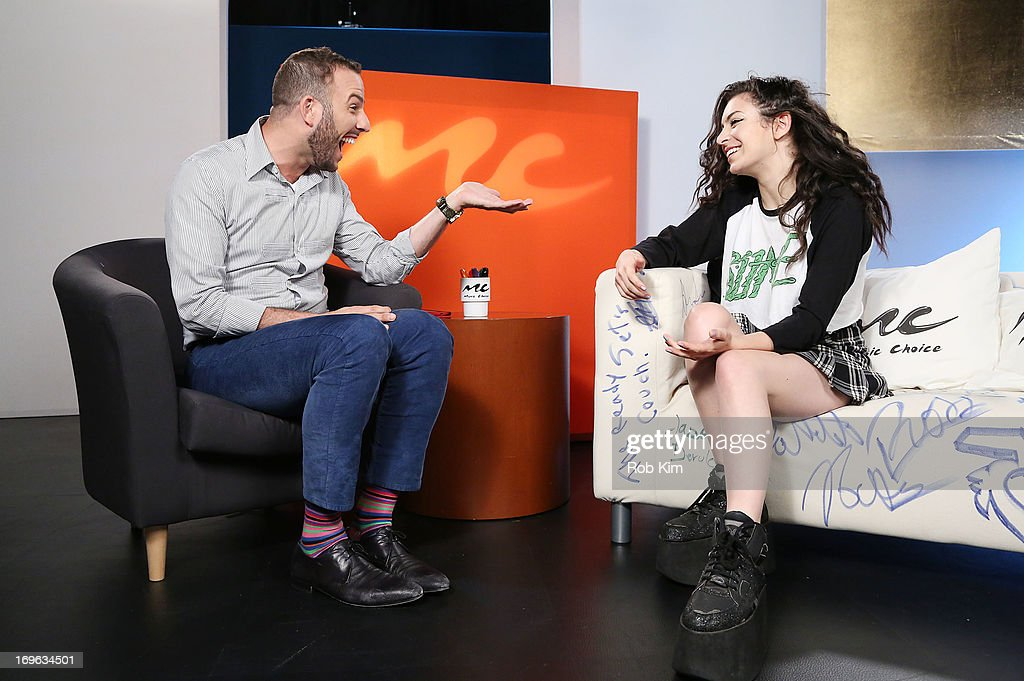 <a gi-track='captionPersonalityLinkClicked' href=/galleries/search?phrase=Charli+XCX&family=editorial&specificpeople=5807231 ng-click='$event.stopPropagation()'>Charli XCX</a> (R) and host <a gi-track='captionPersonalityLinkClicked' href=/galleries/search?phrase=Micah+Jesse&family=editorial&specificpeople=4838538 ng-click='$event.stopPropagation()'>Micah Jesse</a> visit Music Choice's 'U&A' at Music Choice on May 29, 2013 in New York City.