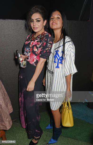Charli XCX and Mabel McVey attend the LOVE magazine x Miu Miu party held during London Fashion Week in association with Absolut Elyx at Loulou's on...