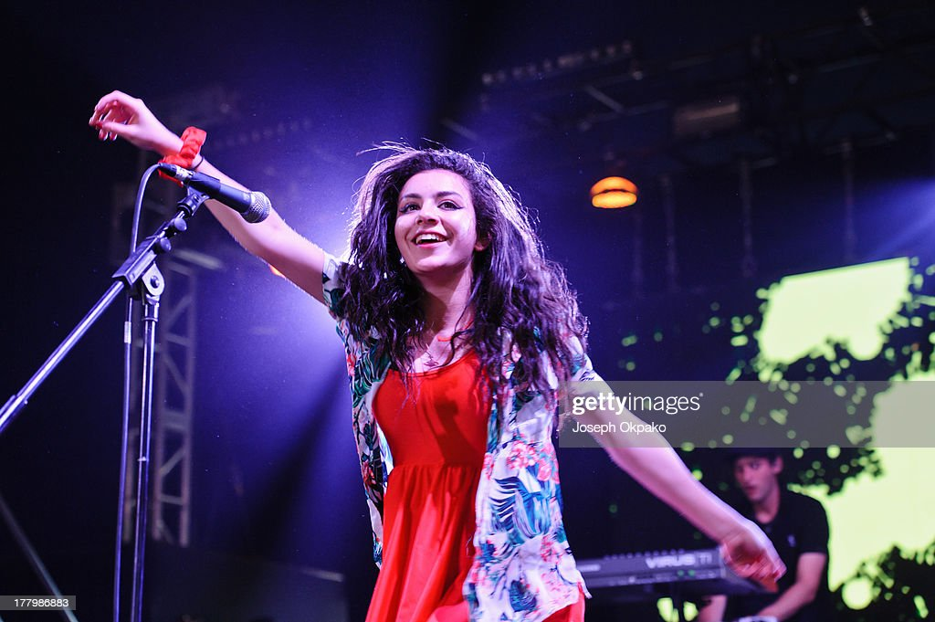 <a gi-track='captionPersonalityLinkClicked' href=/galleries/search?phrase=Charli+XCX&family=editorial&specificpeople=5807231 ng-click='$event.stopPropagation()'>Charli XCX</a> performs on stage on Day 3 of Reading Festival 2013 at Richfield Avenue on August 25, 2013 in Reading, England.