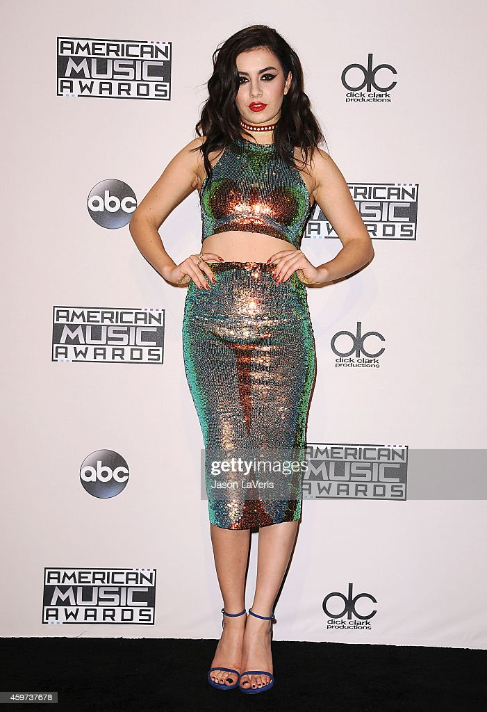 Charli XCX poses in the press room at the 2014 American Music Awards at Nokia Theatre LA Live on November 23 2014 in Los Angeles California