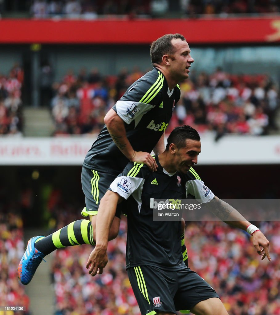 <a gi-track='captionPersonalityLinkClicked' href=/galleries/search?phrase=Charlie+Adam&family=editorial&specificpeople=3987843 ng-click='$event.stopPropagation()'>Charlie Adam</a> celebrates on the shoulders of goalscorer <a gi-track='captionPersonalityLinkClicked' href=/galleries/search?phrase=Geoff+Cameron&family=editorial&specificpeople=5101639 ng-click='$event.stopPropagation()'>Geoff Cameron</a> of Stoke City during the Barclays Premier League match between Arsenal and Stoke City at Emirates Stadium on September 22, 2013 in London, England.
