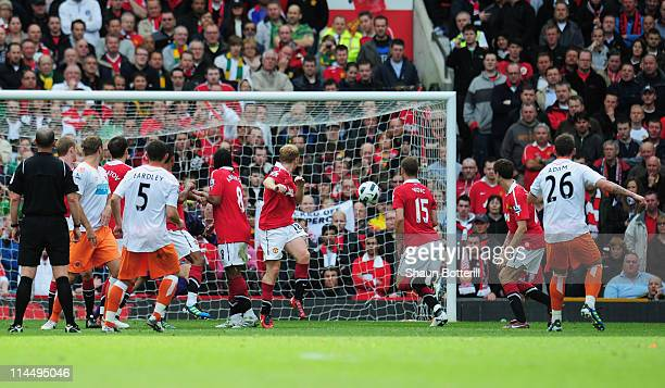 Charlie Adam of Blackpool scores their first goal from a free kick during the Barclays Premier League match between Manchester United and Blackpool...