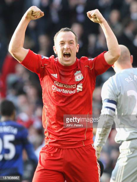Charlie Adam of Liverpool celebrates at the final whistle during the FA Cup Fourth Round match between Liverpool and Manchester United at Anfield on...