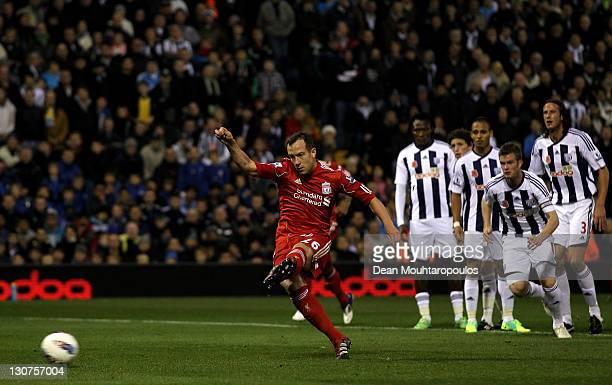 Charlie Adam of Liverpool scores the opening goal from a penalty kick during the Barclays Premier League match between West Bromwich Albion and...