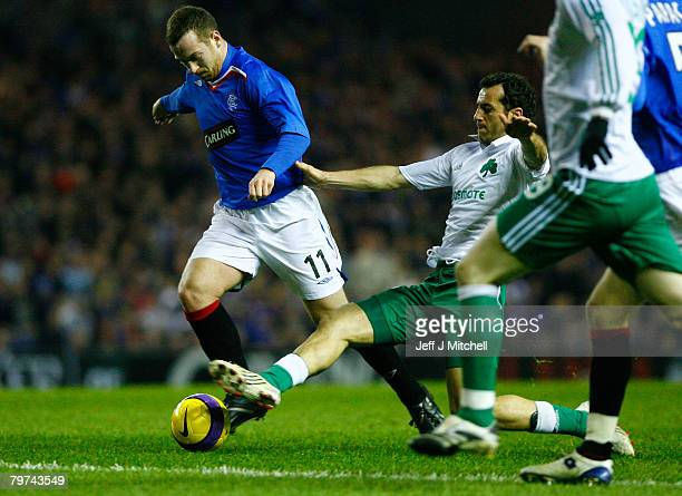 Charlie Adam of Rangers is tackled by Ioannis Goumas of Panathinaikos during the UEFA Cup round of 32 first leg match at Ibrox Stadium February 13...