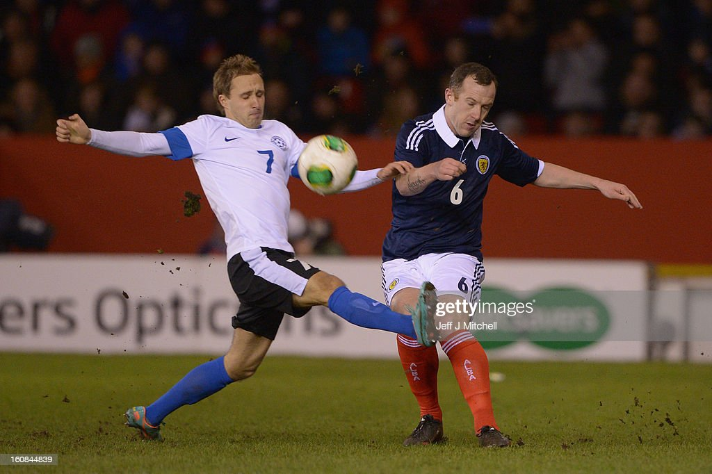 <a gi-track='captionPersonalityLinkClicked' href=/galleries/search?phrase=Charlie+Adam&family=editorial&specificpeople=3987843 ng-click='$event.stopPropagation()'>Charlie Adam</a> of Scotland tackles Sandar Puri of Estonia during the international friendly match between Scotland and Estonia at Pittodrie Stadium on February 6, 2013 in Aberdeen, Scotland.