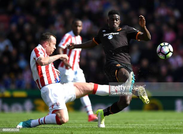 Charlie Adam of Stoke City and Alfred N'Diaye of Hull City battle for possession during the Premier League match between Stoke City and Hull City at...