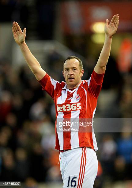 Charlie Adam of Stoke City celebrates as he scores their first goal during the Barclays Premier League match between Stoke City and Aston Villa at...
