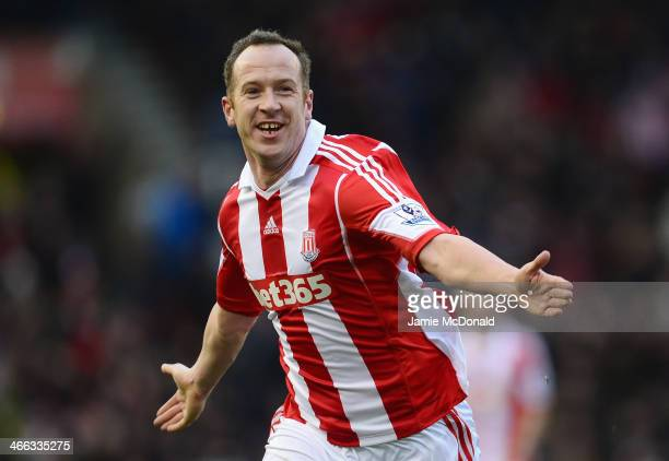 Charlie Adam of Stoke City celebrates scoring the opening goal during the Barclays Premier League match between Stoke City and Manchester United at...