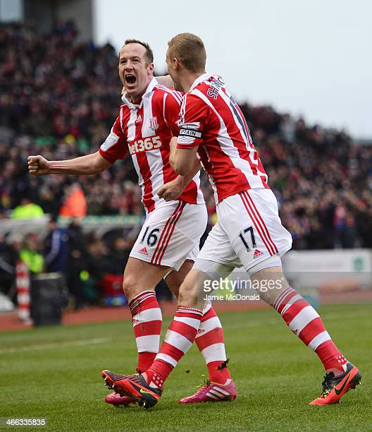 Charlie Adam of Stoke City celebrates scoring the opening goal with Ryan Shawcross during the Barclays Premier League match between Stoke City and...