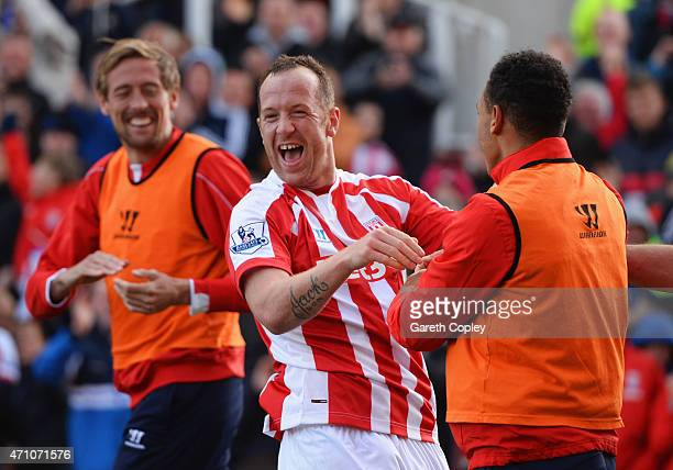 Charlie Adam of Stoke City celebrates scoring their first goal with Peter Crouch and Peter Odemwingie of Stoke City during the Barclays Premier...