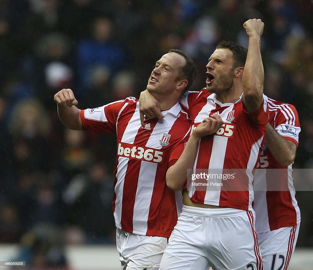 Charlie Adam (L) of Stoke City celebrates scoring their second goal during the Barclays Premier League match between Stoke City and Manchester United at Britannia Stadium on February 1, 2014 in Stoke on Trent, England.