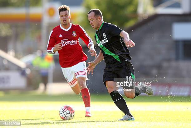 Charlie Adam of Stoke City controls the ball from James Gray of Wrexham during the pre season friendly match between Wrexham and Stoke City at...